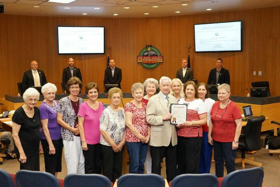 Pearland Mayor Tom Reid holds the Flag Day proclamation.