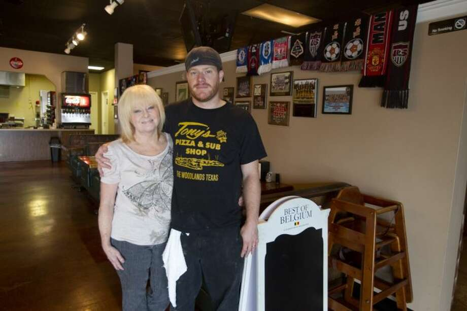 Ryan D'Avignon poses for a photo with his mom, Barbara, who helps her son with Greek Tony's Pizza in Spring. The family-oriented restaurant was opened by Ryan's dad, Greg D'Avignon, who passed away in 2011. The establishment remains a go-to for local sports teams and sports fans.
