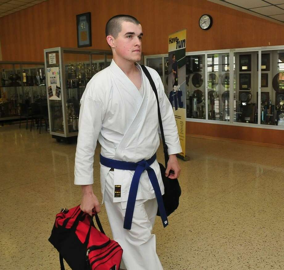 Recent San Jacinto College graduate, Cody Scurlock, took physical education courses that included a karate class at the College to improve his health while also preparing for his transfer to the University of Houston-Clear Lake in the Fall to study kinesiology. Photo credit: Jeannie Peng-Armao, San Jacinto College marketing, public relations, and government affairs department.