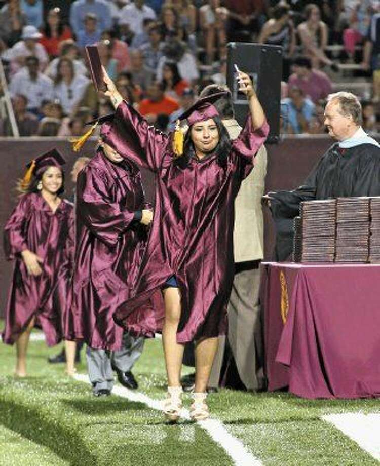There were no shortage of happy graduates as the Deer Park Class of 2015 received their diplomas Thursday night, June 4. Photo: Kar B Hlava