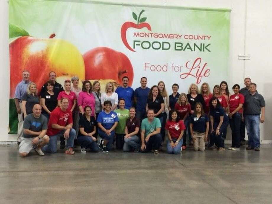 """The Woodlands Area Economic Development Partnership's partners participated in the Montgomery County Food Bank's """"Sort to Support Challenge"""" on May 29."""