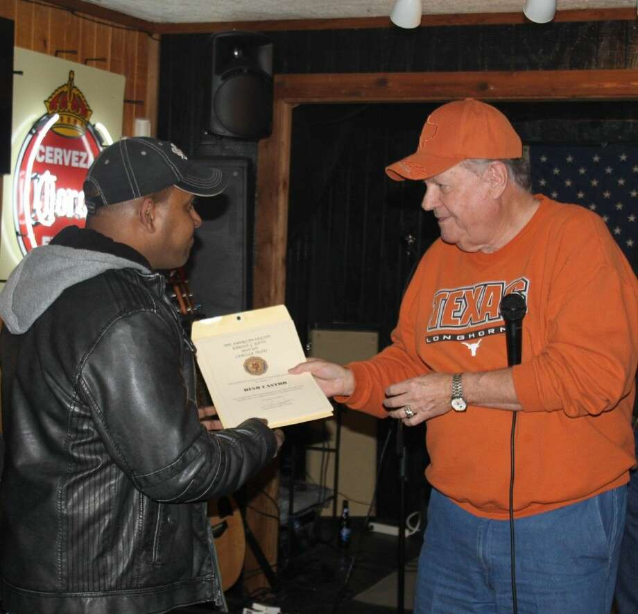 "Dale Everitt (right) of American Legion Post 629 presents Pascoal Rodriguese (left) with a certificate of appreciation in memory of Conbino ""Bino"" Crasto. Similar certificates are expected to go to Crasto's family in India. Photo: Jacob McAdams"