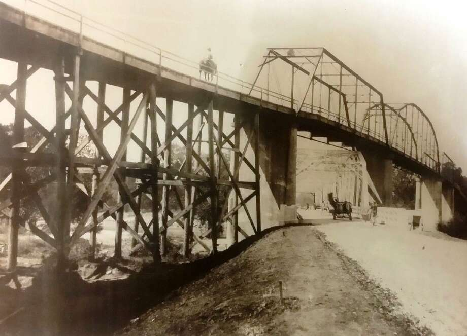 A wooden bridge used to span the Trinity River between Liberty and Dayton. This photo, taken in the early 1900s, is part of the vast collection of artifacts at the Sam Houston Regional Library in Liberty. The wooden bridge was torn down to make way for other structures. Photo: Sam Houston Regional Library