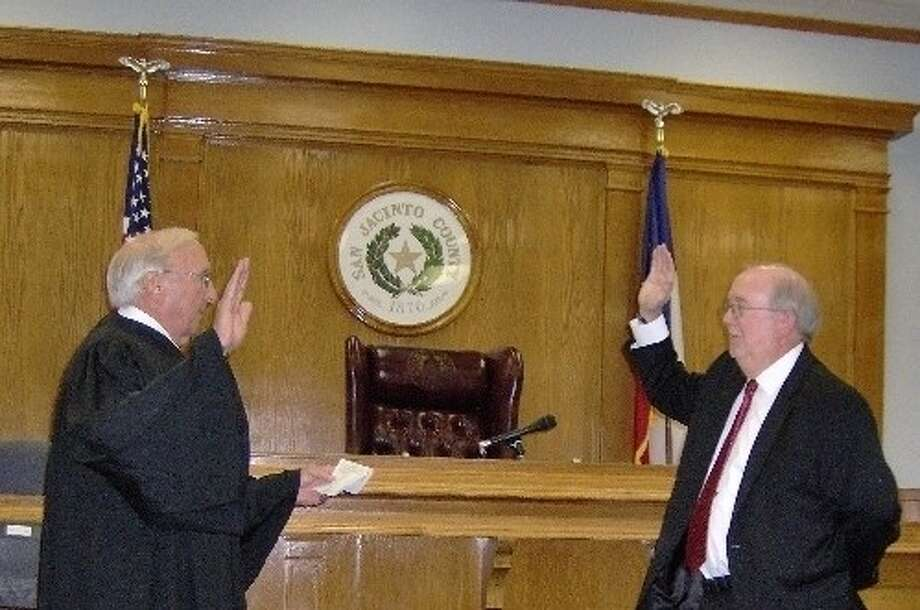 Senior District Judge David Wilson (left) prepares to swear in Robert Trapp (right) as the newest District Attorney in San Jacinto County. Photo: Submitted