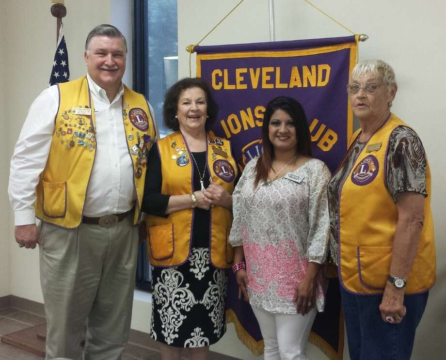 Heaven's Army founder Lanora Purvis spoke at the June 9 meeting of the Cleveland Lions Club on the topic of human trafficking. Cleveland Lions Club members Mike Penry, Beverly Eriks and Estelle Trevathan were among those in the audience. Photo: Stephanie Buckner