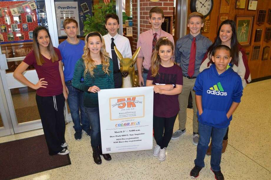 The Deer Park Junior High BIG RED Caring Community class is hosting the Colorful Future 5K on Saturday, March 5 to help two Deer Park ISD students with medical expenses. Pictured are eighth-graders (Front row) Kailah Gonzales, Kayla Konvicka, Stevee LeMaire, and Humberto Rojas, (second row) Ryan Rehbein, Arnold Perez, Cody Camp, Tyler Davidson, and Reyna Holifield. Photo by Jeri M. Martinez/DPISD Communications