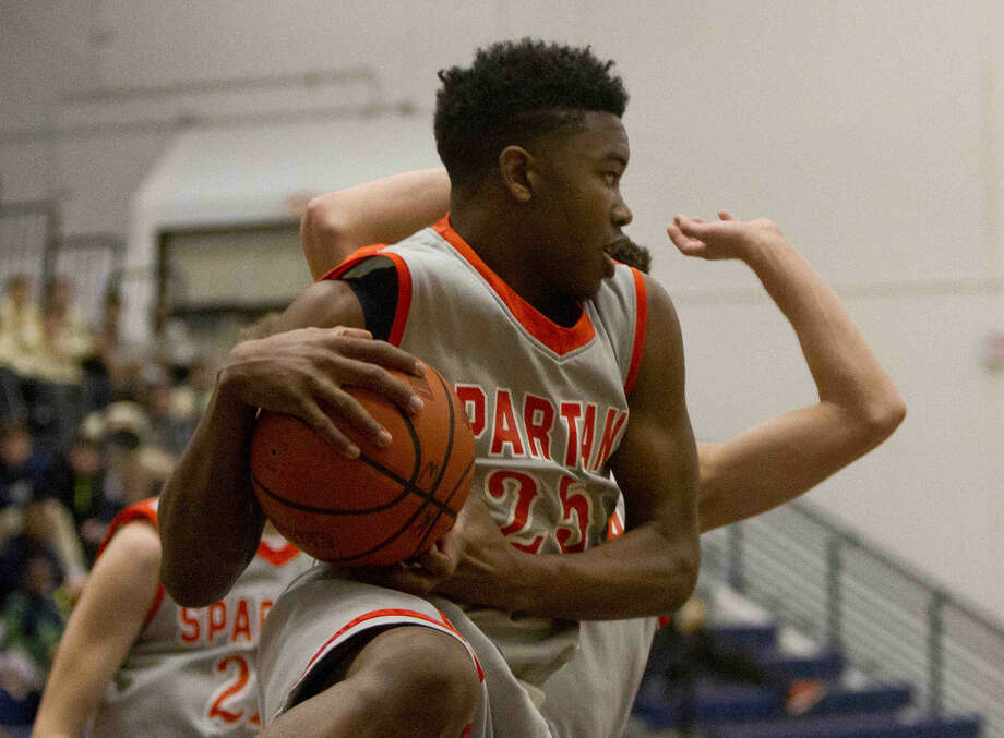 Kenneth Pleasant and Seven Lakes defeated Mayde Creek 68-55 to improve to 7-4 in District 19-6A. The Spartans are tied with Strake Jesuit for third place. Visit HCNPics.com for more photos. Photo: Jason Fochtman
