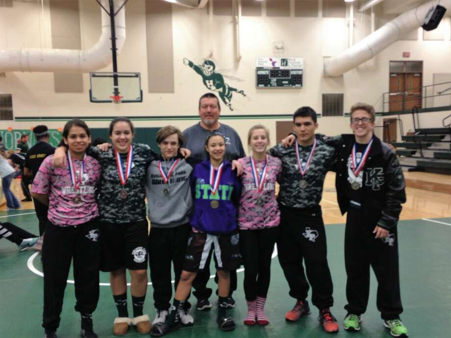 Kingwood Park wrestling coach Sam Knight joins his Regional Qualifiers for a picture which includes Ritz  Toscano, Reyna Aguilar, Calvin Laird, Lex Harris, Amanda  Squyres, Xavier Reneau and Isaac Squyres.  Brittney White and Blake Whichard were not available.