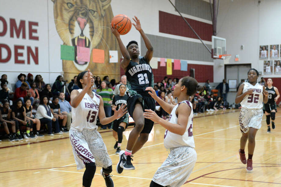 Hightower's Reyna Ammons attempts a shot between defenders during their District 23-6A game Feb. 5 at Kempner High School. The Lady Hurricanes won 55-41 to repeat as district champions. To view or purchase this or additional photos, visit HCNPics.com Photo: Craig Moseley