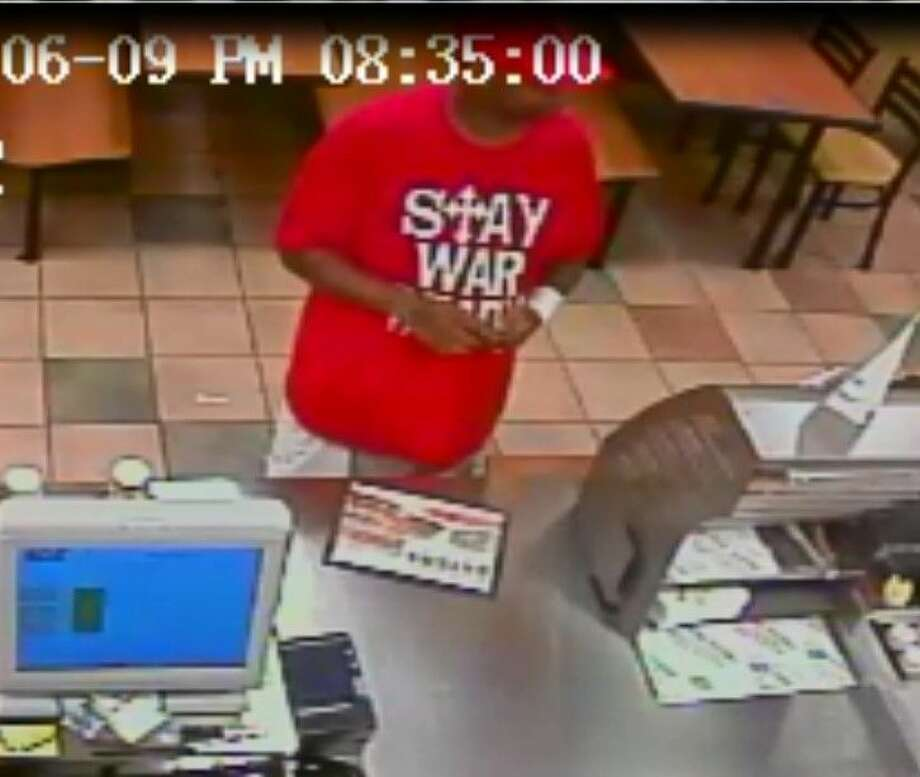 """Witnesses said the suspect wore a red cap and a distinctive red shirt that read """"Stay War Ready"""" in large font across the front. Photo: Courtesy Pearland Police"""