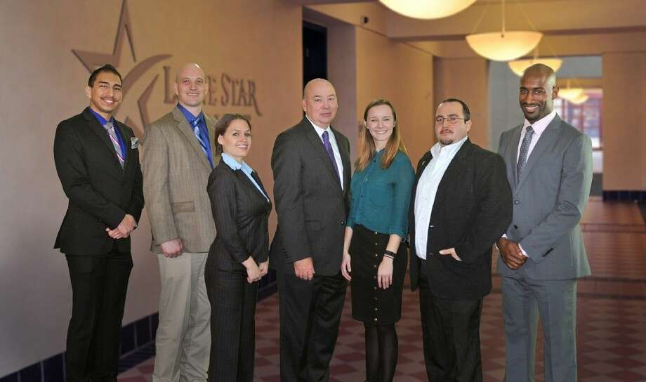 Winners of the Lone Star College Foundation student essay contest with Dr. Stephen C. Head, LSC chancellor. Pictured left to right are: Jeremy Martinez, LSC-Montgomery; Gerald Hallford, LSC-Tomball; Krista Garrie, LSC-CyFair; Dr. Stephen C. Head, LSC chancellor; Ariana Velazco, LSC-Kingwood; Jesse Rodriquez, LSC-University Park; Eric Thompson, LSC-North Harris student. Photo: Submitted
