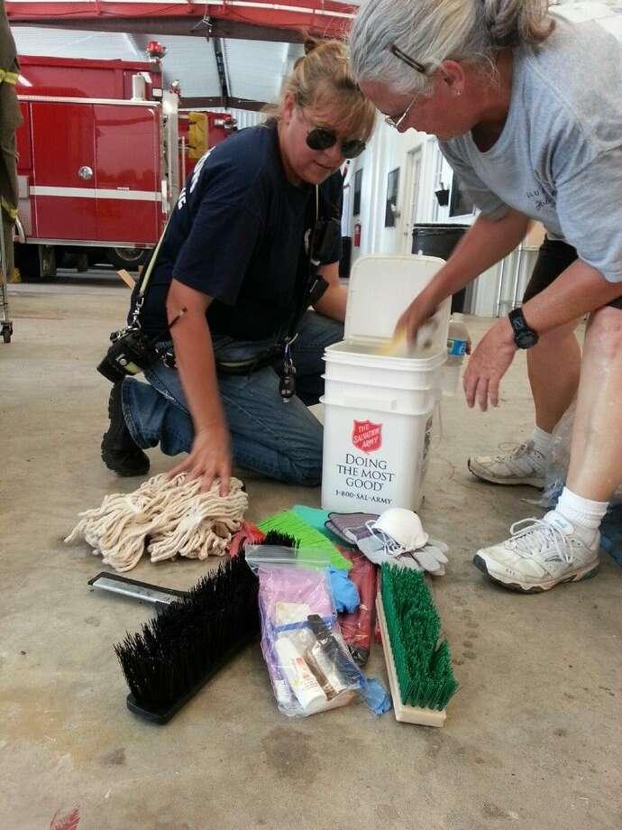Kneeling is Debbi Dunlap, Rosharon Firefighter, and Gina Stepchinsky.
