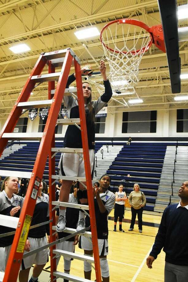 Tomball Memorial celebrated their second district championship in two years by cutting down the nets.