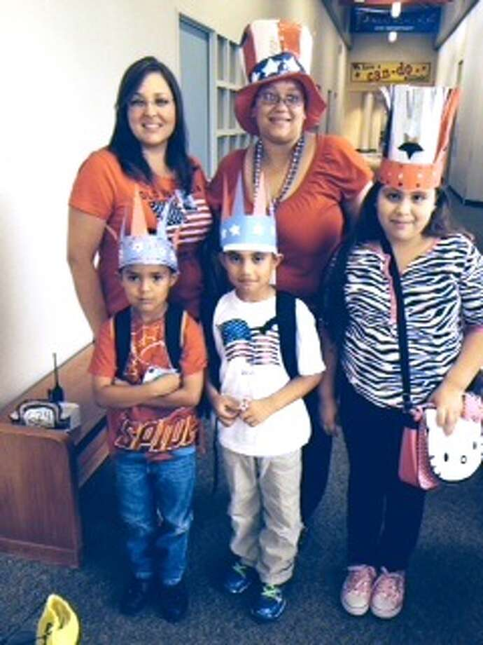 Pictured (left to right) are: students Jorge Garcia, Juan Monge and Marissa Magana;  Summer School Facilitator Rosy Martinez and Summer School Principal Elizabeth Williams. Photo: Photo Courtesy Burton Elementary School