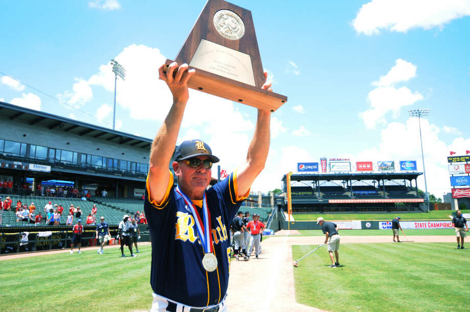 Cy Ranch head coach John Pope hoists the 6A state championship trophy Saturday in Round Rock. Photo: Tony Gaines/HCN