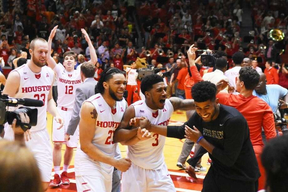 The University of Houston Cougars celebrate together after a 71-68 win over No. 12 Southern Methodist University Monday, February 1, 2016 at Hofheinz Pavilion. SMU is the highest-ranked opponent Houston has beaten since a 1996 victory over No. 3 Memphis. Photo: Tony Gaines