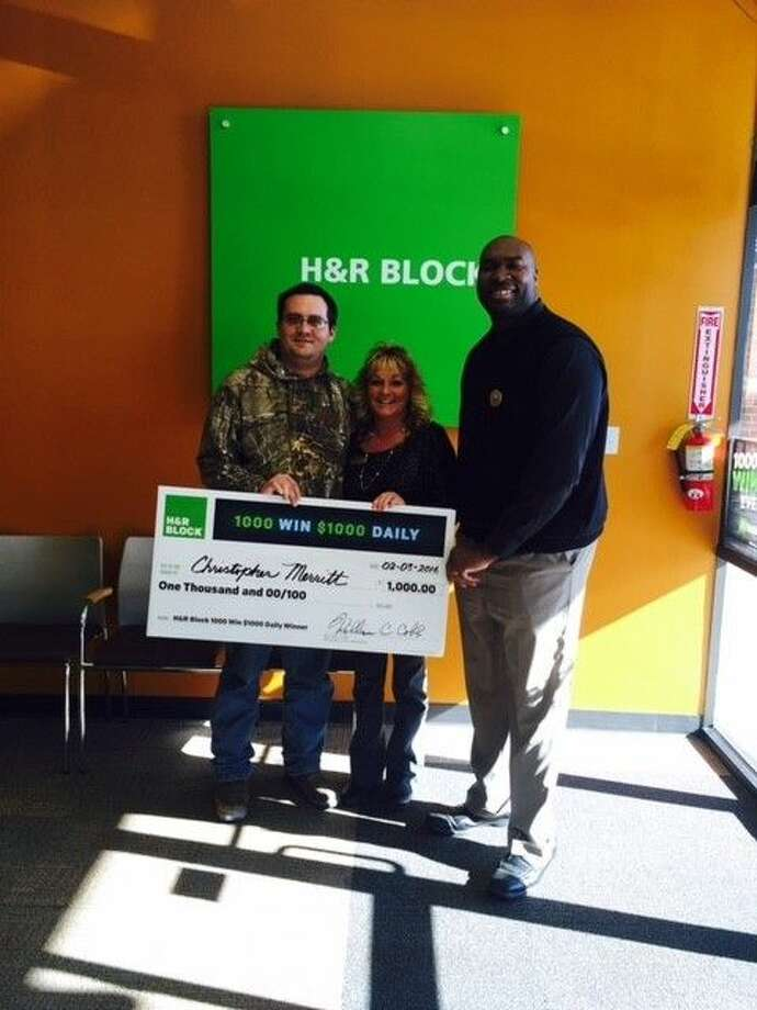 Sweepstakes winner Christopher Merritt along with Christie Beatty and Kenny Biley of H&R Block. Photo: Christie Beatty