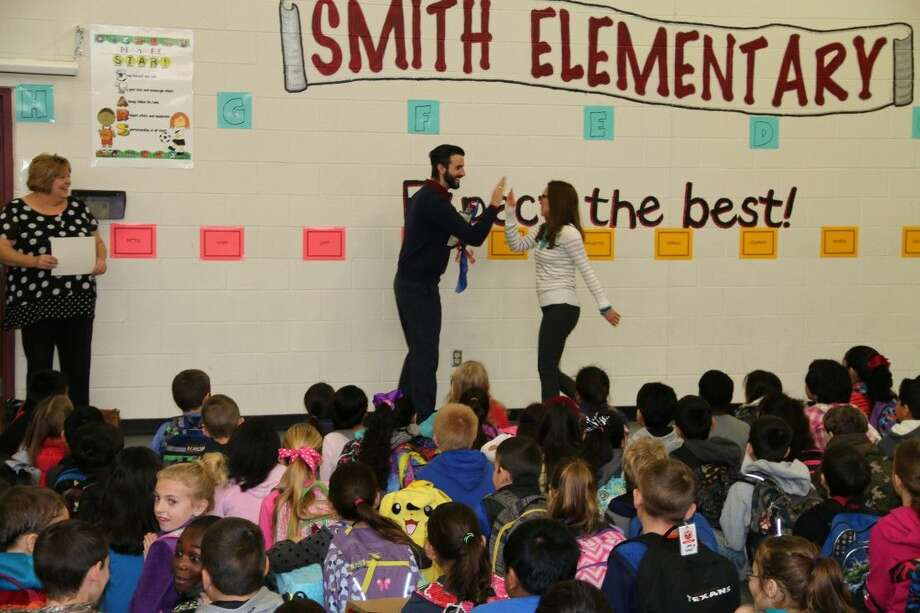 Ms. Medford and Mr. Mead, both winners from Smith Elementary, congratulate each other. Photo: Submitted