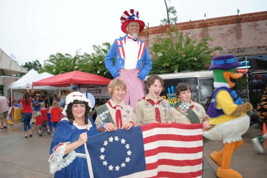 Boy Scouts from Troup 89 pose with actors portraying Uncle Sam and Betsy Ross at the 25th Annual Star-Spangled Salute featuring the Houston Symphony at The Cynthia Woods Mitchell Pavilion Thursday night. Pictured are Trace Blackketter, a student at Caney Creek High, Dalton Davenport, a student at College Park High and Jon Whitney, a student at Knox Junior High.