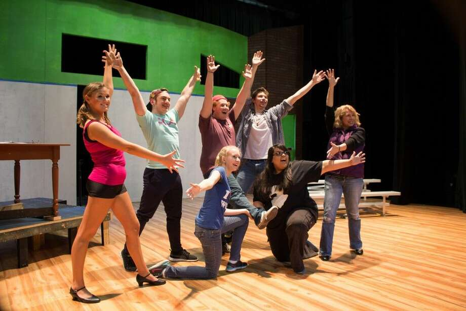 "Cast members of ""The 25th Annual Putnam County Spelling Bee"" practice the end pose of ""Magic Foot"" during rehearsals. Pictured are L to R (back row): Marcy Park (Lauryn Ferguson), Chip Tolentino (Austin Colburn), William Barfee' (Christian Peck), Leaf Coneybear (Daniel Robnett), Rona Lisa Perretti (Wendy Jones). L to R (kneeling): Logainne Schwartzandgrubenierre (Elizabeth Walker) and Olive Ostrovsky (Brianna Steptoe)."