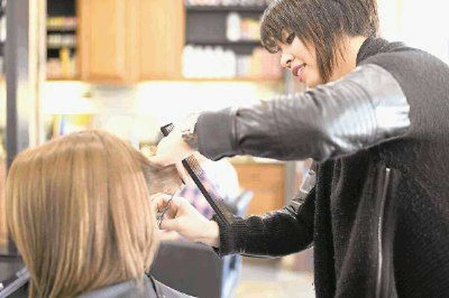 """""""A stylist can change more than a client's appearance. We have the ability to help them transform their lives- especially in the case of domestic violence,"""" said Angelica L Salon owner Angelica Lynch."""