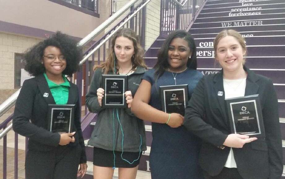 Friendswood High DECA members show off their awards as they advance to state competition.