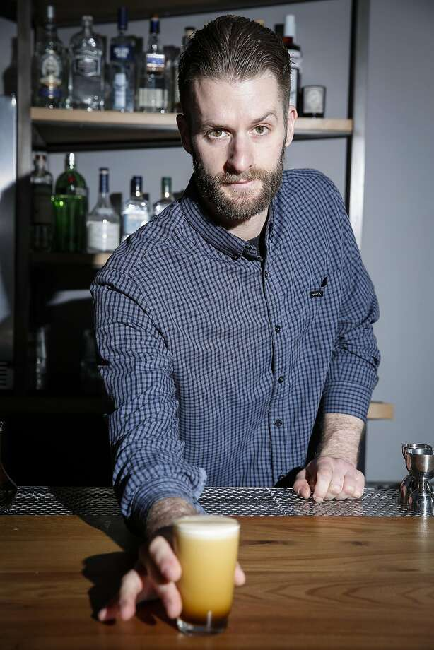 Maxwell Monroe, the ABV bartender who created the Alpine Eye Opener, with his drink. Photo: Russell Yip, The Chronicle