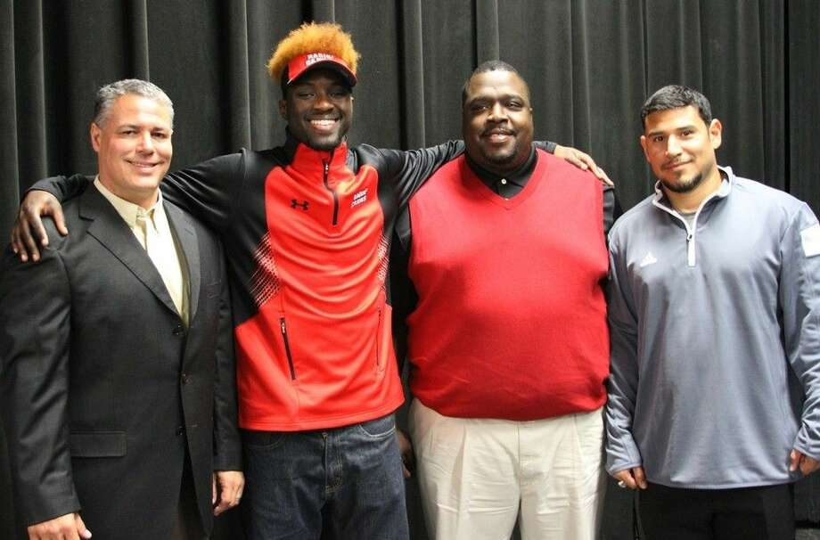 Coldspring-Oakhurst High School senior Edward Hayes was named Texas ASPE All-State First Team Defensive Back for the 2015 season. Pictured from left to right are COCISD Athletic Director Mark Byrd, Ed Hayes, Offensive Coordinator S.B. Pierson and Defensive Coordinator Nick Flores. Photo: Submitted