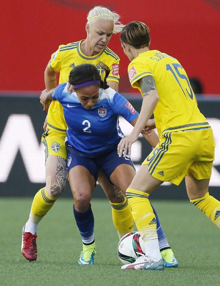 Sweden's Caroline Seger (17) and Therese Sjogran (15) go for the ball against United States' Sydney Leroux (2) during FIFA Women's World Cup in Winnipeg, Manitoba, Canada, Friday.