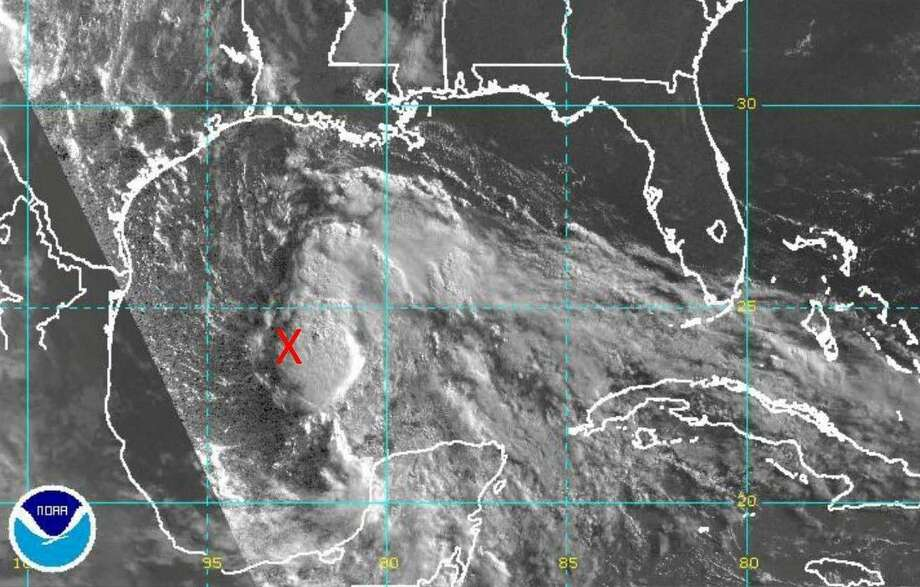 A satellite image shows the size of a tropical disturbance off the Texas coast. As of 1:30 p.m. Monday, the storm was still unnamed. Should it develop into a tropical storm or depression, it will be named Bill.