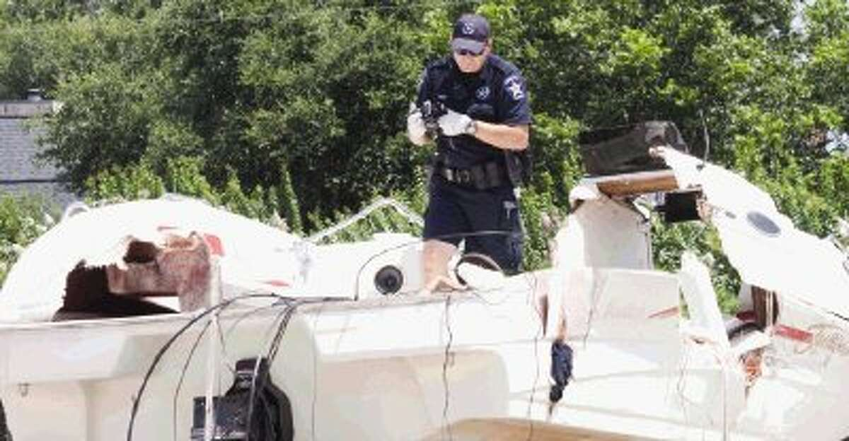 A Constable with Montgomery County Precinct 1 helps recreate the scene of a fatal boating accident that occurred on Tuesday evening on Lake Conroe. As of Wednesday afternoon, the two-boat incident left three victims dead.