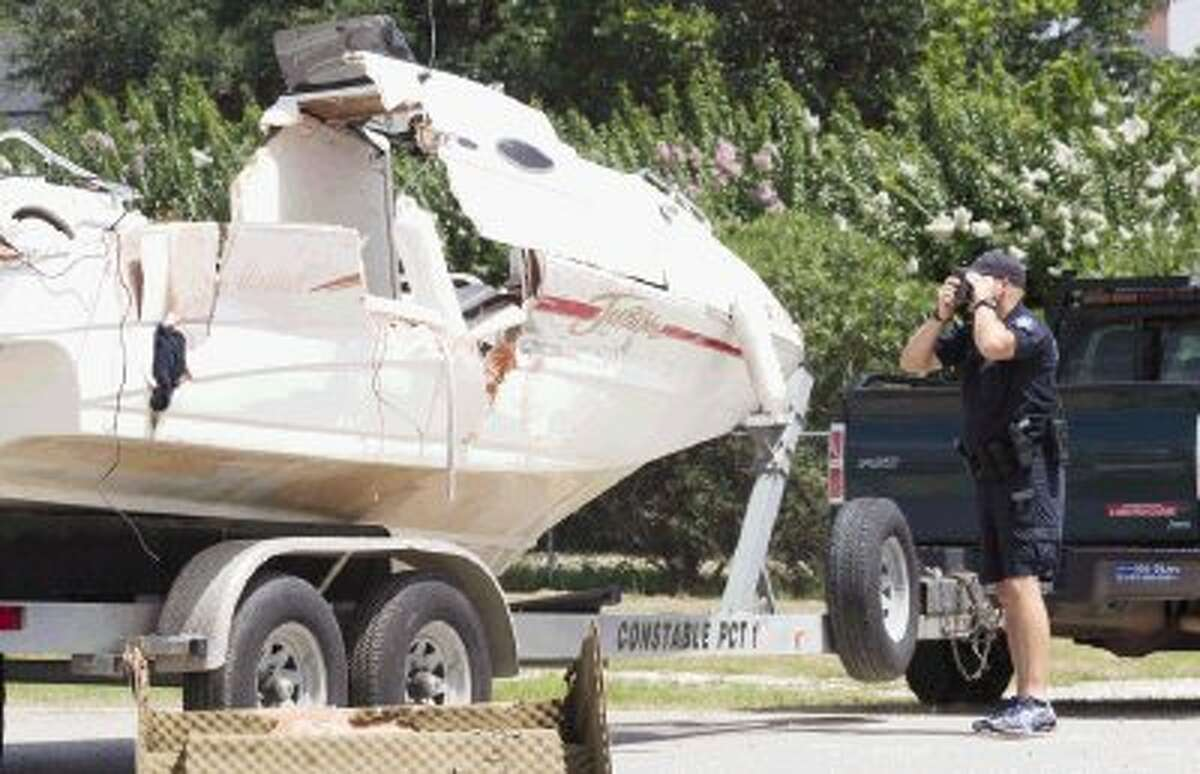 A constable with Montgomery County Precinct 1 investigates the scene of a fatal boating accident that occurred on Tuesday evening on Lake Conroe. As of Wednesday afternoon, the two-boat incident left three victims dead.