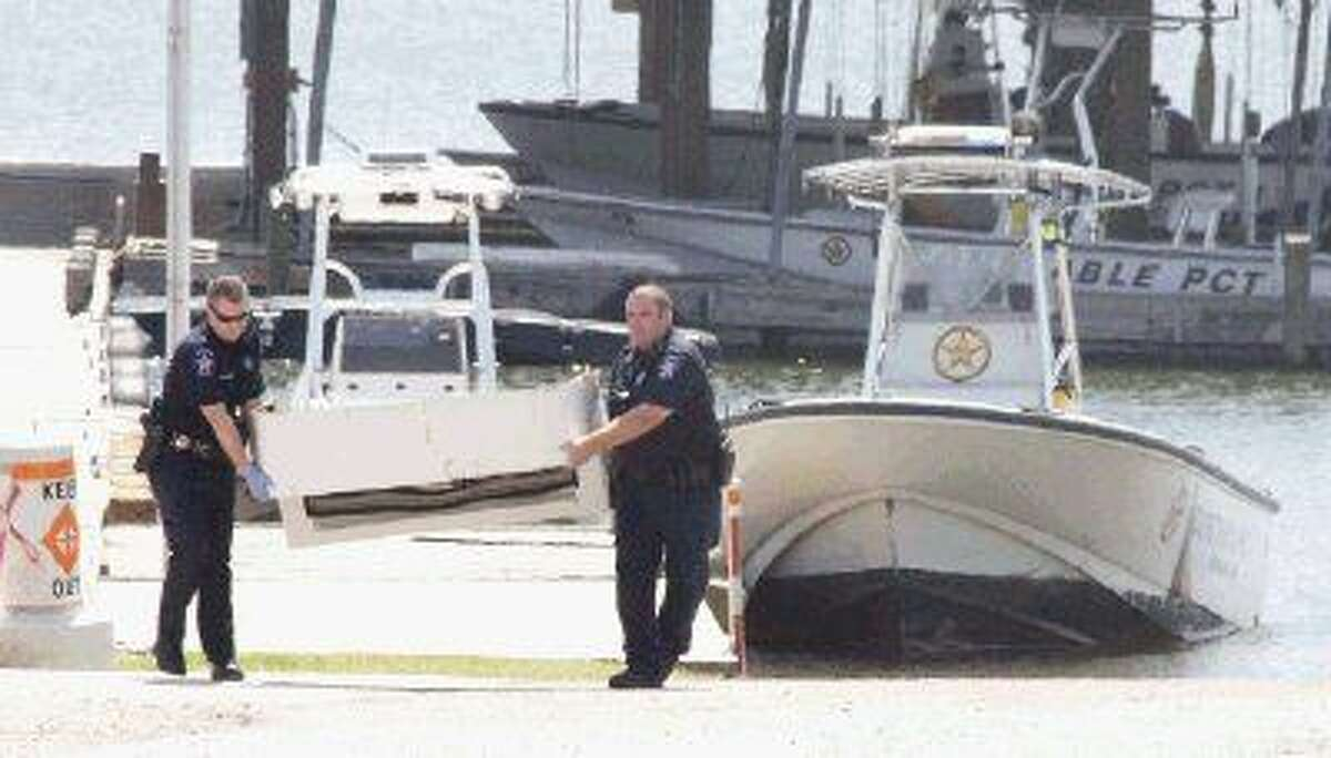 Constables with Montgomery County Precinct 1 transport part of a boat involved in a fatal boating accident that occurred the evening of July 1 on Lake Conroe. The crash resulted in the deaths of three people, two adult sisters and one of their children.