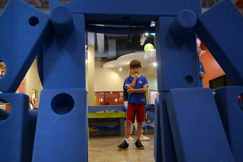 Evan Moore, 10, of The Woodlands, ponders his next move on his block play creation during the first annual Sensory Friendly Day event at The Woodlands Children's Museum on April 20.