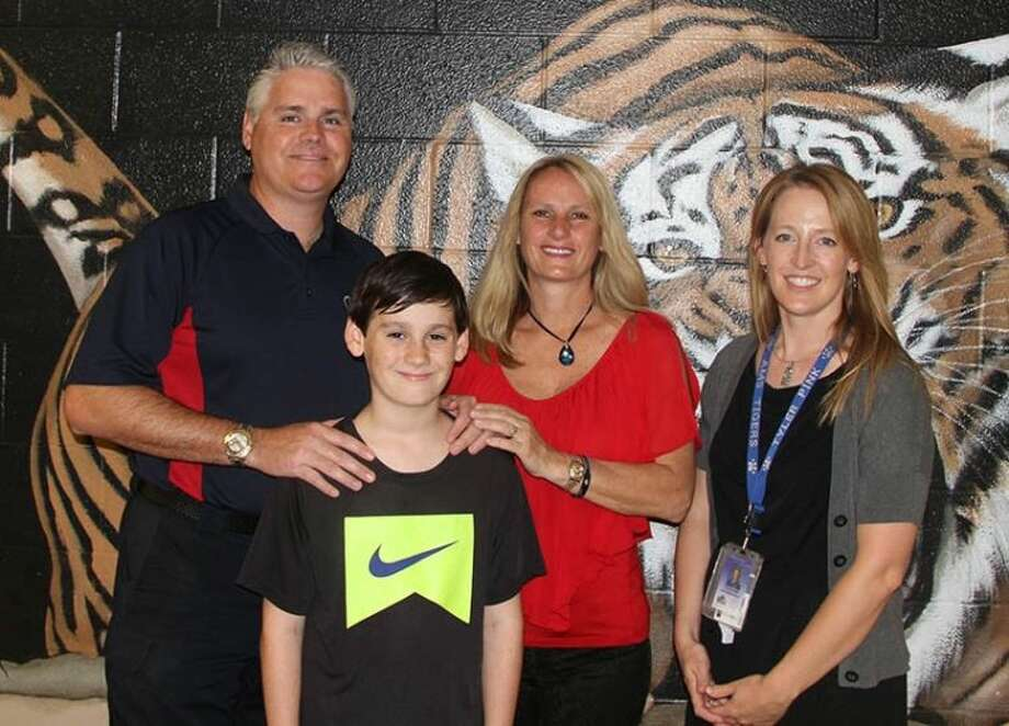 From left, Representative Dan Huberty, wife Janet Huberty, son Ryan Huberty and his teacher Tyler Beth Pink.