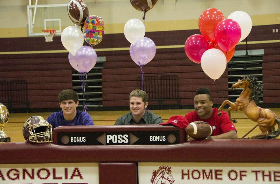 From left to right: Tyler Ferre signed to Stephen F. Austin, Mason Storrs signed to Millsaps College and Damar'ren Mitchell signed to play for the University of Louisiana-Lafayette Wednesday, Feb. 3, 2016 at Magnolia West High School. Photo: Emily Page