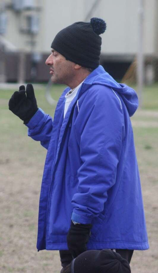 There will be no more speeches to the team when the wind chill makes the temperature feel like 25 degrees as Bijan Timjani was doing on this day, following a 2014 practice. Chris Parker has been named to head the Texans program. Photo: Robert Avery