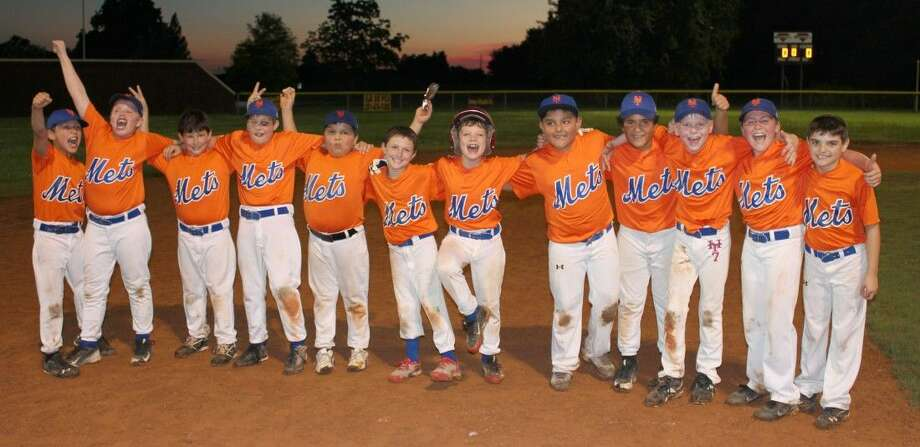 The Mets recently captured Deer Park Pony League's Mustang Division city championship with a spotless 14-0 record. Celebrating the first-ever Mustang Division crown in Deer Park history are from (L-R), Mikael Kidd, Keagan Warner, Ethan Burdick, Connor Bitterly, Nicolas Falcon, Kenny Cook, Landon Sanders, Adrian Ramirez, Erasmo Canales, Joshua Anderson, Reed Mallett and Keaton Erdmann. The title game was able to be played on May 29 after some very hard work by coaches turned a wet field into a playable one, allowing the kids to decide the title they've been pursuing for two months.