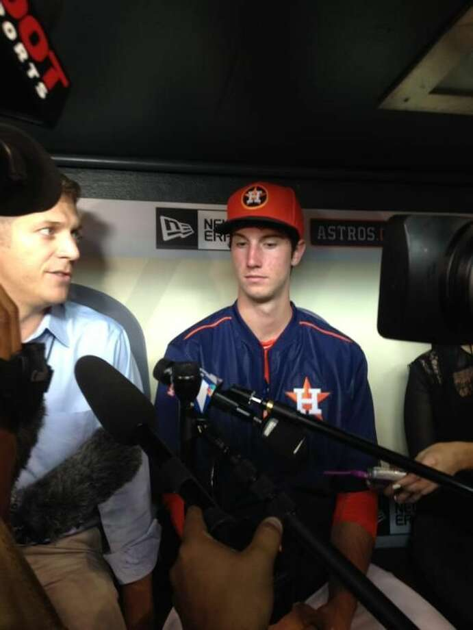 Astros outfielder Kyle Tucker speaks to the media after becoming the first 2015 MLB Draft pick to sign with Houston. Photo: Staff Photo By Cameron Brock