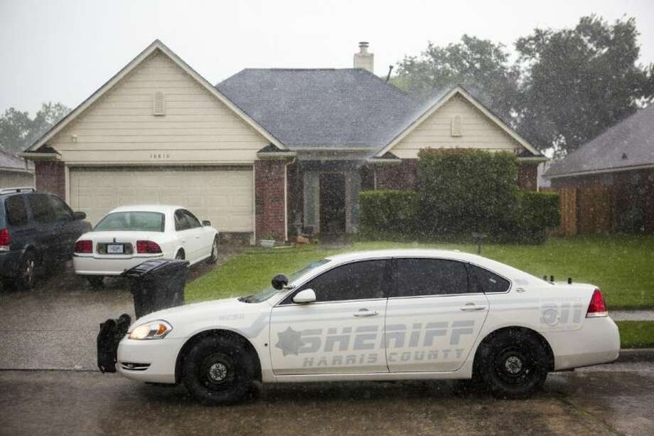 Harris County Sheriff's Department officers serve a search warrant July 3, 2014, at a residence on the 18000 block of Barry Lane in Atascocita. Staff photo by Andrew Buckley