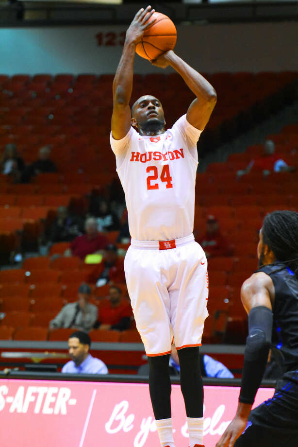 University of Houston senior forward Devonta Pollard shoots over University of Memphis senior forward Shaq Goodwin Wednesday, February 10, 2016 at Hofheinz Pavilion. Goodwin scored 24 points in the contest, but Pollard bested him in the matchup, notching a career-high 34 points to key the Cougars to a 98-90 victory over the Tigers. Photo: Tony Gaines