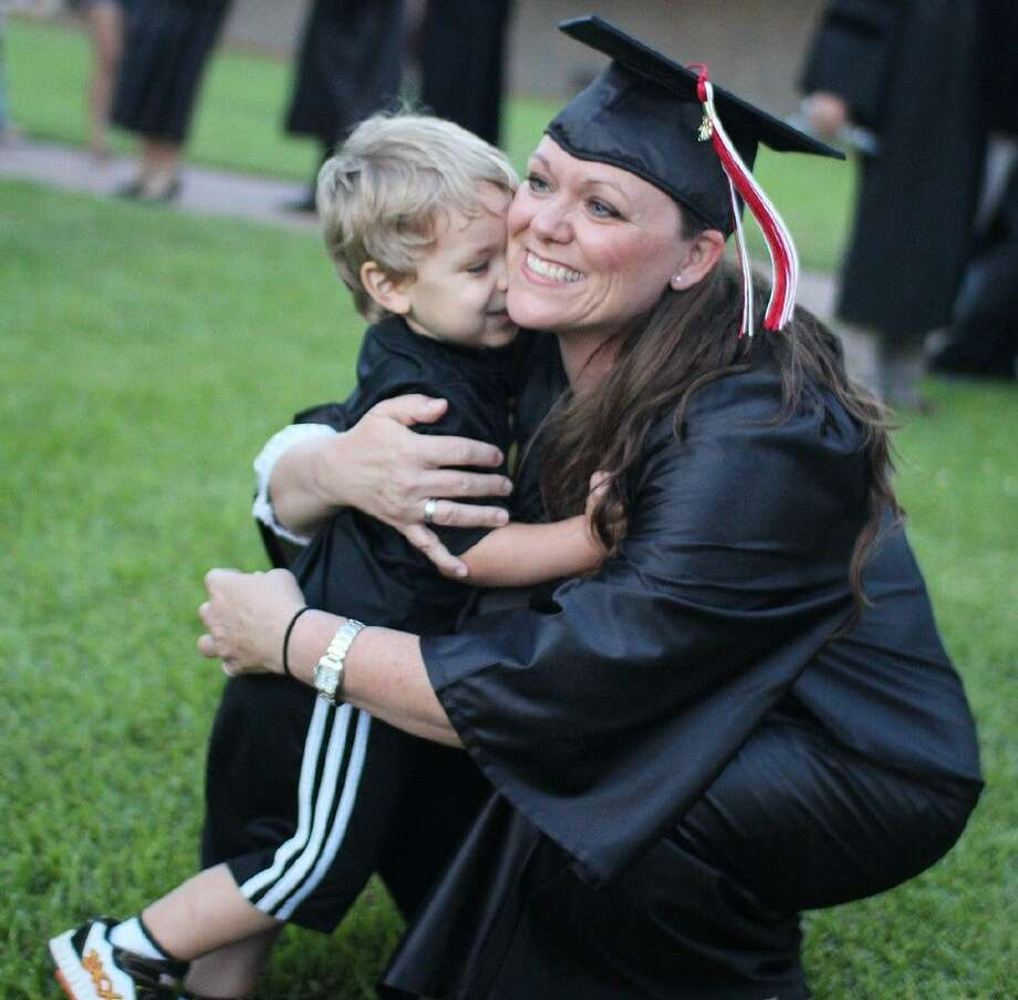 Kimberly Shappley gets a hug from her son Kaleb after graduating from nursing school.