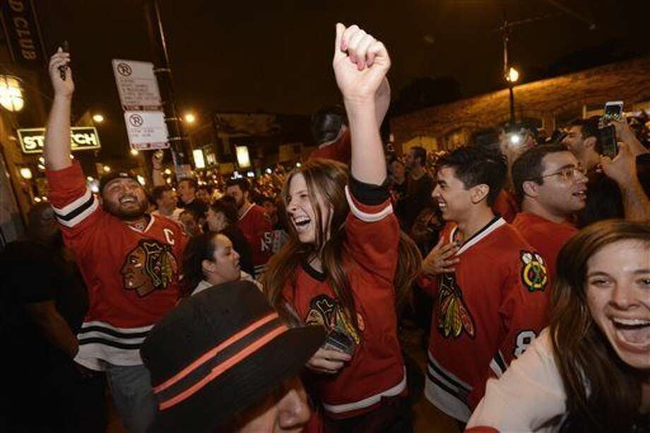 Chicago Blackhawks fans celebrate on Clark street in the Wrigleyville neighborhood after the Chicago Blackhawks won the Stanley Cup, defeating the Tampa Bay Lightning in Chicago on Monday, June 15, 2015. (AP Photo/Paul Beaty) Photo: Paul Beaty