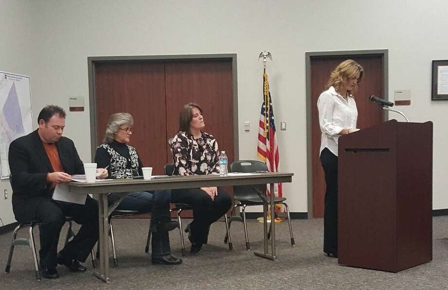 Citizens Advisory Committee Leadership Committee members deliver a presentation outlining district facility recommendations to the Huffman ISD Board of Trustees on Tuesday, Feb. 9. From left to right: Mark Johnson, Robin Colbert, Donya Pendergrass and D'Ann Bailey.
