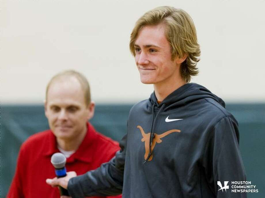 The Woodlands' Daniel Golden signed to run cross country for the University of Texas during a signing day ceremony Wednesday. To purchase this photos and others like it, go to HCNpics.com. Photo: Jason Fochtman