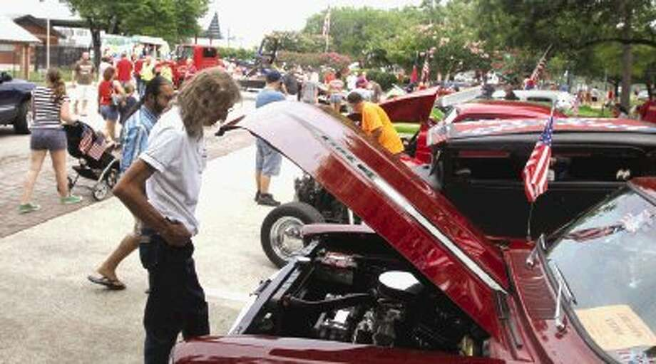 Visitors enjoyed classic cars, food and music during the Oak Ridge Fourth of July celebration at Marilyn Edgar Park Friday. To view or purchase this photo and others like it, visit HCNpics.com. / Jason Fochtman