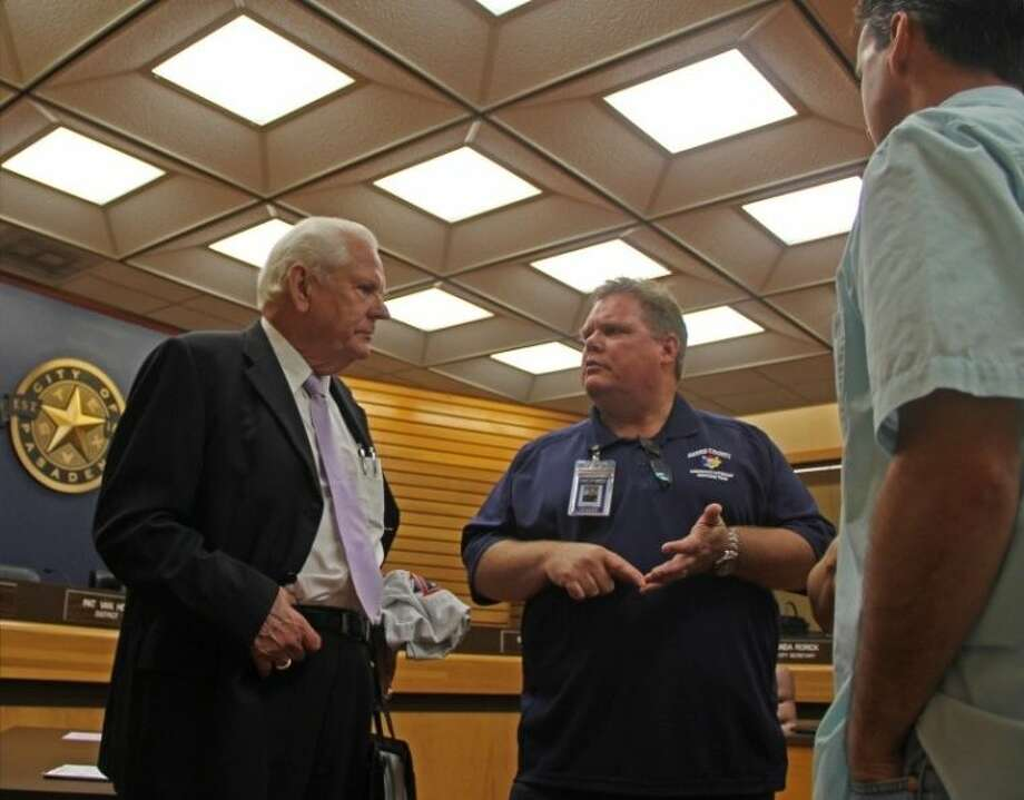 Pasadena City Councilmember Don Harrison visits with former Assistant Fire Chief Richard Lawhorn after a recent city council meeting. Photo: KRISTI NIX