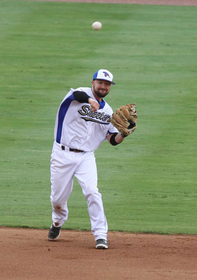 Sugar Land Skeeters shortstop Taylor Harbin fields a ball during a game with the Camden Riversharks July 3 at Constellation Field in Sugar Land. The Skeeters won 6-4 to sweep the series. Photo: Alan Warren