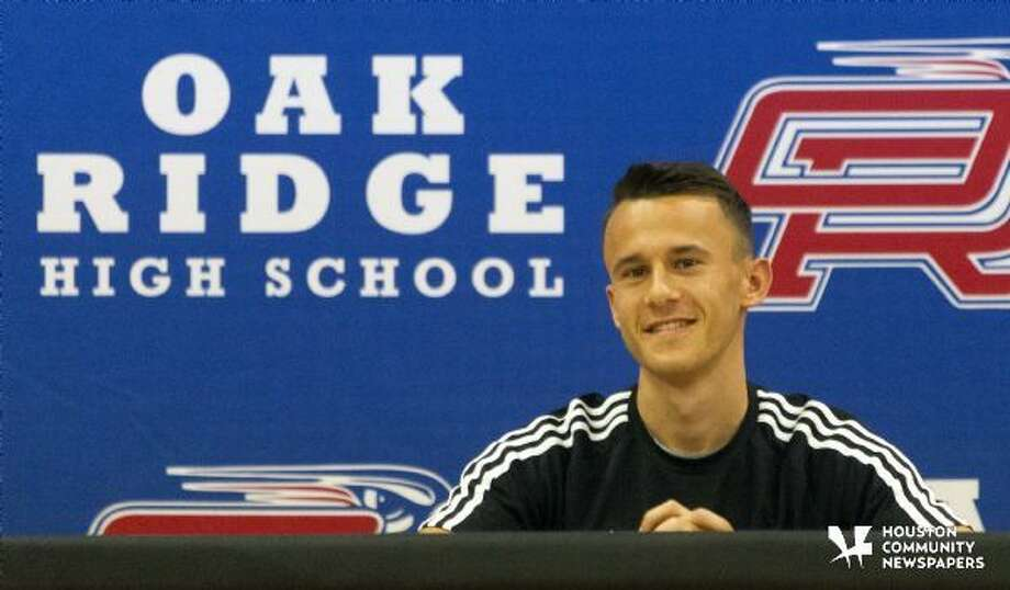 Oak Ridge's Logan Aucoin signed to play soccer with Mary Hardin-Baylor during a signing day ceremony Wednesday. Photo: Jason Fochtman