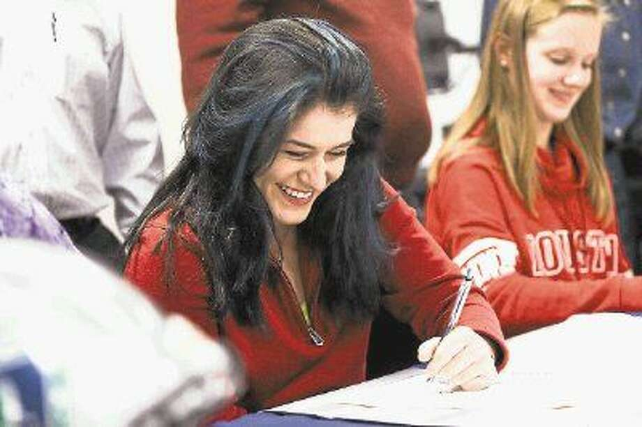 College Park's Kathryn Hodges signs with Muhlenberg College during a Signing Day ceremony on Wednesday at College Park High School. Photo: Michael Minasi